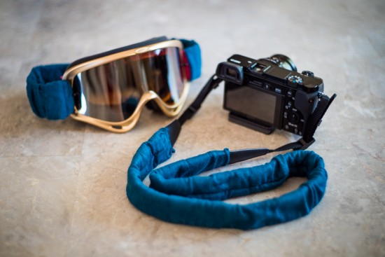Camera strap and goggle strap covers for Burn