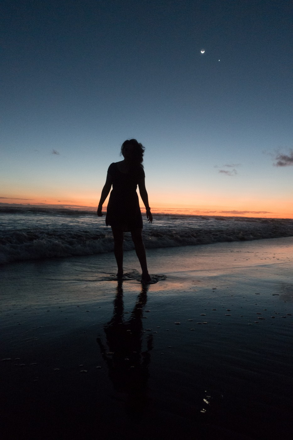 Sony RX-100 III photography sample: woman's silhouette on beach at sunset