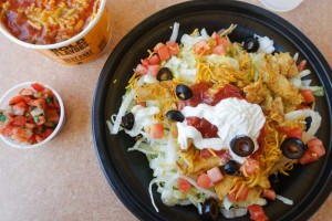 Taco John's taco salad with a side of refried beans