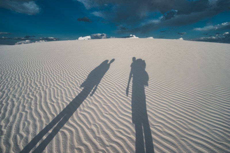 couple's shadow at White Sands National Monument, New Mexico