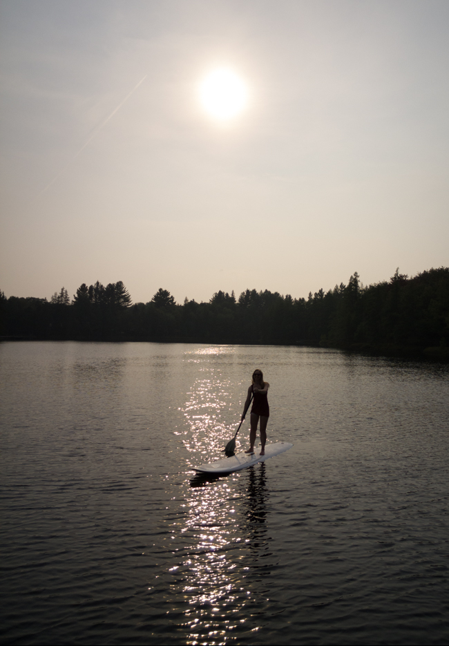 paddleboarding on a lake in the Adirondacks